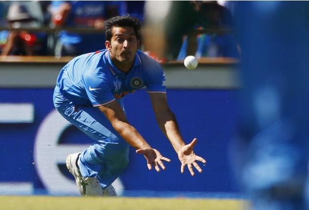 India's Mohit Sharma dives for a catch during a play which resulted in West Indies batsman Marlon Samuels being run out during their Cricket World Cup match in Perth