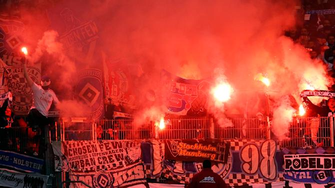 Hamburg supporters light flares before their German first division Bundesliga soccer match in Stuttgart