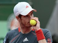 Andy Murray (pictured in Paris, on June 6) has passed a late fitness test and will lead the field at the pre-Wimbledon Queen's club grass event starting on Monday