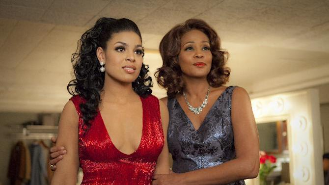 """FILE - In this undated file image provided by Sony Pictures Entertainment, singer-actresses Jordin Sparks, left, and Whitney Houston are shown in a scene from the upcoming film """"Sparkle."""" The song, """"Celebrate,"""" a duet with Jordin Sparks from Houston's last movie debuted Monday on Ryan Seacrest's website and will be available on iTunes June 5. The film opens in theaters on August 17. (AP Photo/Sony Pictures, Alicia Gbur, File)"""