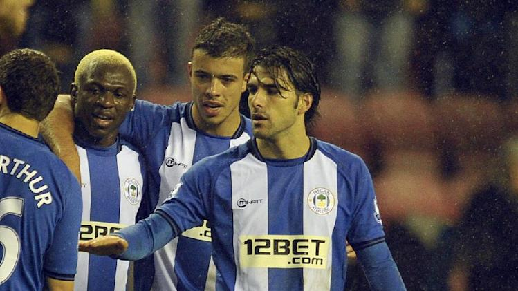 Jordi Gomez, right, scored a hat-trick to answer his critics
