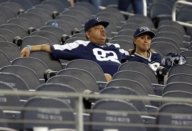 Dallas Cowboys fans sit in their seats after the team's 28-17 loss to the San Francisco 49ers in an NFL football game, Sunday, Sept. 7, 2014, in Arlington, Texas. (AP Photo/LM Otero)