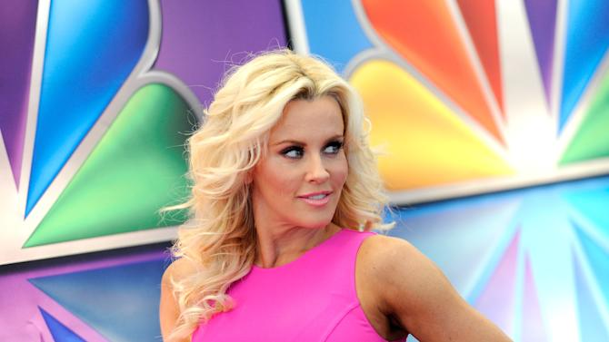 "FILE - This May 14, 2012 file photo shows ""Love In The Wild"" host Jenny McCarthy arrives for the NBC network upfront presentation at Radio City Music Hall in New York. McCarthy, who is from suburban Chicago, released a statement Friday, Aug. 17, 2012, saying that she is no longer romantically involved with Chicago Bears linebacker Brian Urlacher. (AP Photo/Evan Agostini, file)"