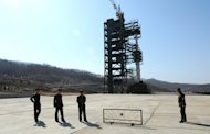 North Korean soldiers stand guard in front of a Unha-3 rocket at the Tangachai -ri space center ahead of a failed launch in April 2012. North Korea has completed installing a long-range rocket on its launch pad, ahead of its planned launch this month in defiance of widespread international condemnation, a report says