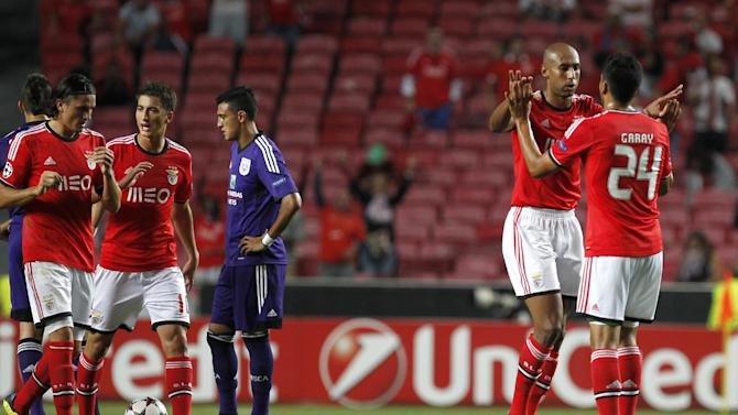 Benfica's Luisao, celebrates with Ezequiel Garay, right, after scoring against Anderlecht during the Champions League group C soccer match between Benfica and Anderlecht Tuesday, Sept. 17, 2013, at Benfica's Luz stadium in Lisbon