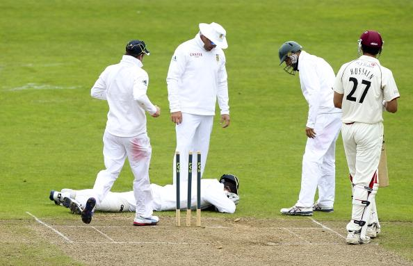 TAUNTON, ENGLAND - JULY 9: Mark Boucher of South Africa lies on the floor after being struck in the face by a bail during a friendly match between Somerset and South Africa on July 9, 2012 in Taunton,