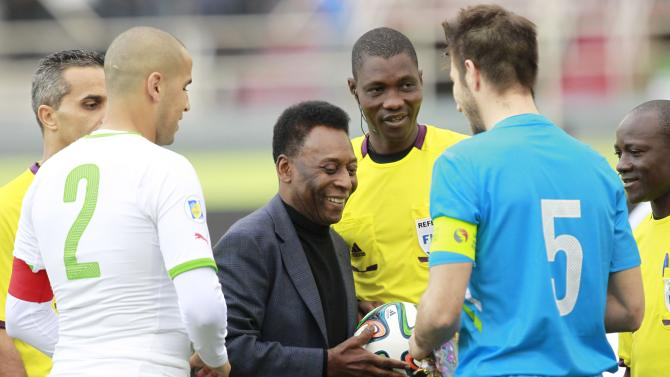 Brazilian soccer legend Pele holds a ball during the international friendly soccer match between Algeria and Slovenia in Algiers