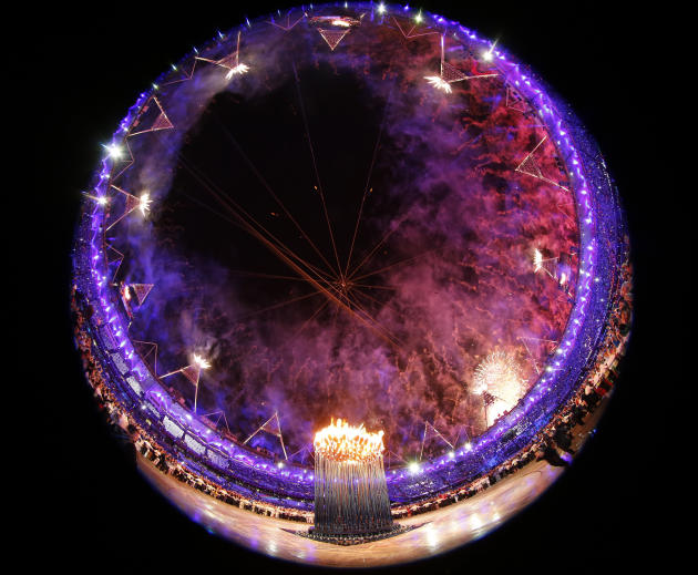 Fireworks explode after the Olympic cauldron was lit during the opening ceremony of the London 2012 Olympic Games at the Olympic Stadium