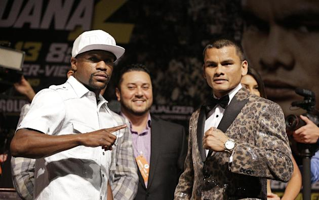 Boxers Floyd Mayweather Jr., left, and Marcos Maidana pose during a press conference Wednesday, Sept. 10, 2014, in Las Vegas. The two are scheduled to fight in a welterweight title fight Saturday in L