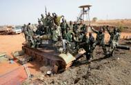 Sudanese soldiers pose on a seized South Sudan tank in the oil region of Heglig in April. UN leader Ban Ki-moon has called on Sudan to move its troops out of the disputed territory of Abyei after rival South Sudan withdrew its security forces