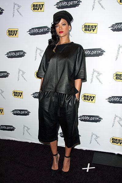 "An exhausted, semi-apologetic Rihanna touches down in NYC and attends her ""Unapologetic"" record release party - An unapologetically baggy leather top and three-quarter pants clash with an unapologetic"