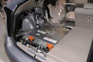 "This file photo shows a lithium-ion battery, installed under the trunk space of a Toyota Motors' Prius plug-in hybrid vehicle cut-model during a in Tokyo, in 2009. Toyota is expanding a tie-up with Germany's BMW on hybrid and fuel-cell vehicle technology as the global automakers push further into the ""green"" market, a report said on Monday"