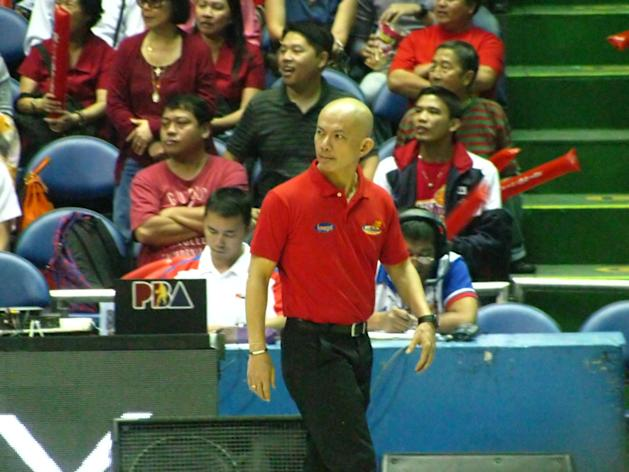 Rain or Shine coach Yeng Guiao watches the action in Game 1 of the Philippine Cup Finals.