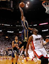 Paul George of the Indiana Pacers dunks over Dwyane Wade of the Miami Heat during Game Two of the Eastern Conference Semifinals in the 2012 NBA Playoffs on May 15, 2012 in Miami, Florida