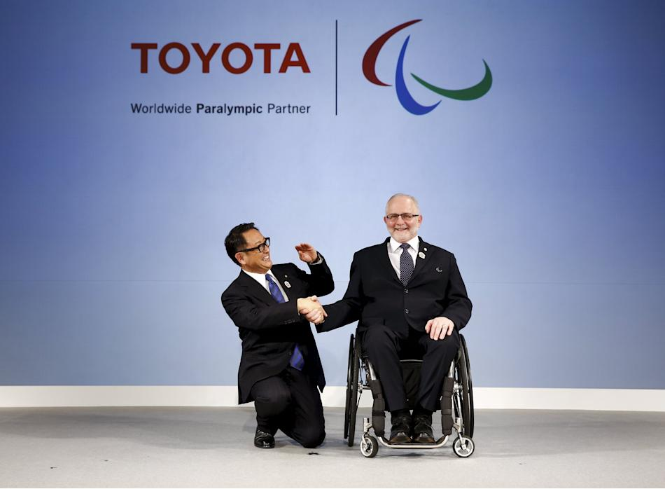 President of the Toyota Motor Corporation Akio Toyoda and President of the International Paralympic Committee Philip Craven shake hands after signing a partnership deal in Tokyo