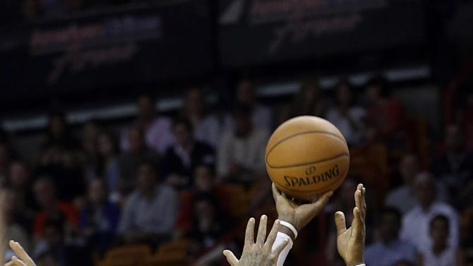 Nuggets add to Heat woes, win in Miami 111-107