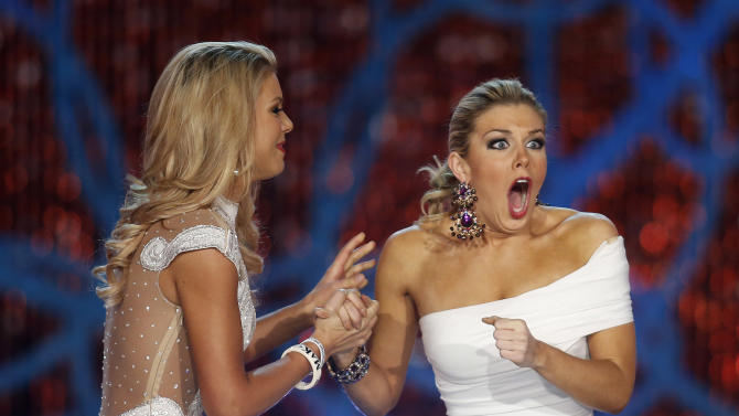 Miss New York, Mallory Hagan, right, reacts with Miss South Carolina Ali Rogers as she is crowned Miss America 2013 on Saturday, Jan. 12, 2013, in Las Vegas. (AP Photo/Isaac Brekken)