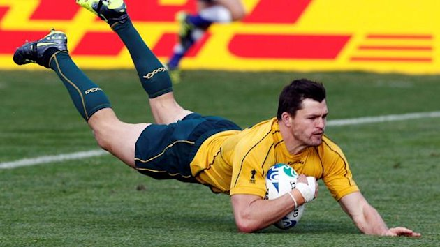 Australia Wallabies' Adam Ashley-Cooper scores a try during their Rugby World Cup Pool C match against Italy at North Harbour Stadium