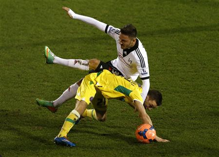 Fulham's Tankovic challenges Sheffield United's Scougall during their English FA Cup soccer match at Craven Cottage in London