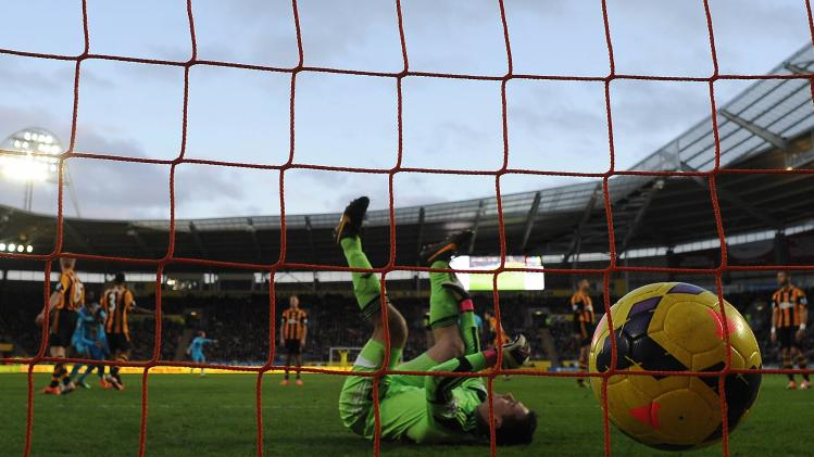 Hull City's Harper reacts after Tottenham Hotspur's Paulinho scored during their English Premier League soccer match at the KC Stadium in Hull