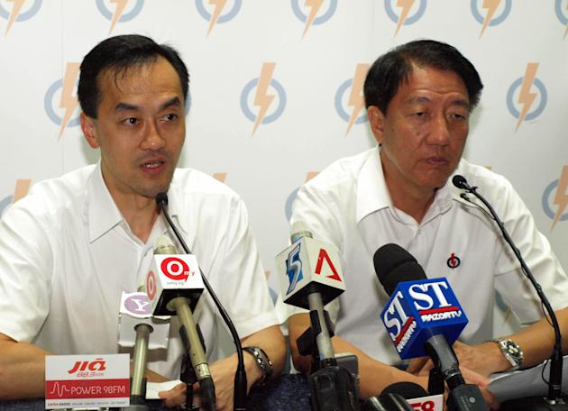 Koh Poh Koon and DPM Teo face the media pack after the defeat.
