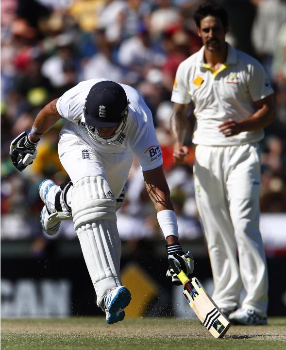 England's Pietersen tries to make his ground as Australia's Johnson looks on during the second day of the third Ashes test cricket match in Perth