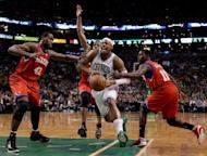 Philadelphia 76ers' Elton Brand (L) and Jrue Holiday (R) defends as Boston Celtics' Paul Pierce (2nd R) heads for the net during game two of the NBA Eastern Conference series on May 14. Philadelphia held on for a 82-81 win over Boston to even their Eastern Conference playoff series at 1-1