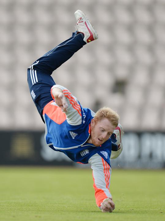 England's Ben Stokes takes a catch during a training session