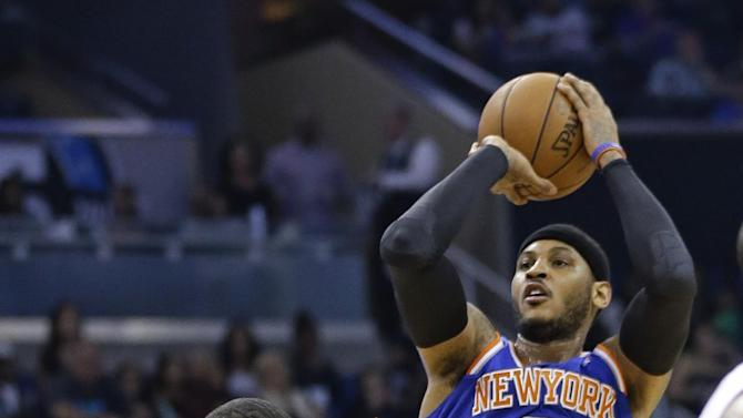 New York Knicks' Carmelo Anthony (7) shoots over Orlando Magic's Tobias Harris (12) in the first half of an NBA basketball game in Orlando, Fla., Monday, Dec. 23, 2013