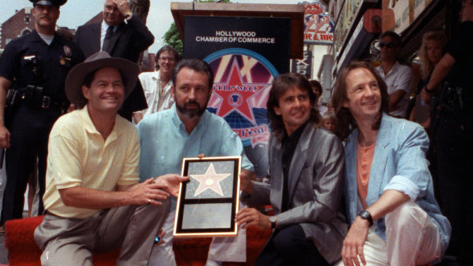 "FILE - In this July 10, 1989 file photo, The Monkees, from left: Micky Dolenz, Mike Nesmith, Davy Jones and Peter Tork  get a star on the Hollywood Walk of Fame in Los Angeles. Jones died Wednesday Feb. 29, 2012 in Florida. He was 66. Jones rose to fame in 1965 when he joined The Monkees, a British popular rock group formed for a television show. Jones sang lead vocals on songs like ""I Wanna Be Free"" and ""Daydream Believer.""    (AP Photo/Mark Terrill, File)"