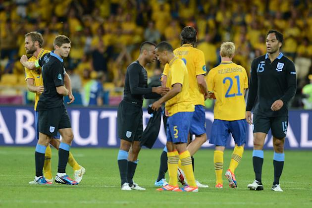 Swedish Defender Olof Mellberg (L) Embraces AFP/Getty Images