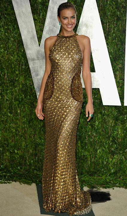 Celebrity fashion gold dresses: At The Vanity Fair Oscar Party, Bar Refaeli held onto the limelight in a patchwork gold halter neck number. We think only a supermodel could pull this off.