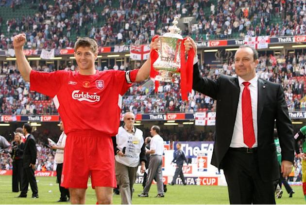 Liverpool manager Raphael Benitez (R) and captain Steven Gerrard lift the FA Cup after Liverpool beat West Ham 3-1 on penalties during the FA Cup final at the Millennium Stadium in Cardiff, May 13, 20