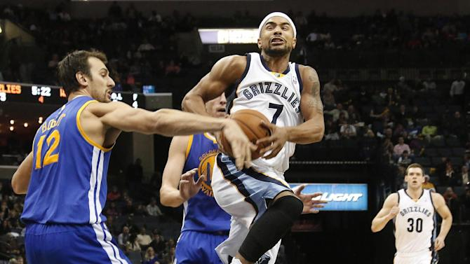 Memphis Grizzlies guard Jerryd Bayless (7) drives against Golden State center Andrew Bogut (12), of Australia, and forward David Lee, back, in the second half of an NBA basketball game Saturday, Dec. 7, 2013, in Memphis, Tenn. Golden State won 108-82