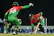Bangladesh cricketer Nasir Hossain (R) plays a shot during the third and final one-day international (ODI) match between Sri Lanka and Bangladesh at the Pallekele International Cricket Stadium in Pallekele on March 28, 2013. Bangladesh defeated Sri Lanka by three wickets