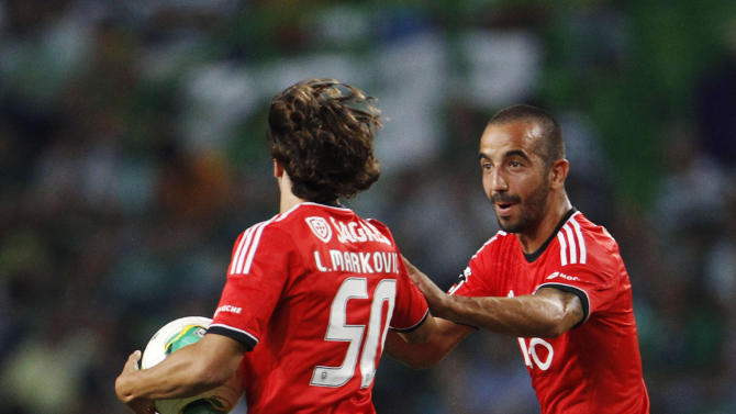 Benfica's Markovic celebrates his goal against Sporting with teammate Amorim during their Portuguese Premier League soccer match in Lisbon