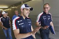 Williams Formula One driver Pastor Maldonado of Venezuela gestures as he walks with team mate Valtteri Bottas (L) of Finland and team members to the drivers' briefing after the second practice session of the Hungarian F1 Grand Prix at the Hungaroring circuit in Mogyorod, near Budapest July 26, 2013. REUTERS/Laszlo Balogh
