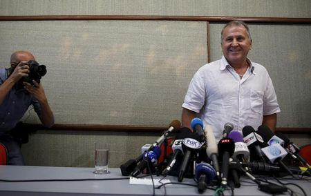 Former Brazil soccer player Zico arrives for a news conference in Rio de Janeiro