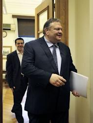 Leader of the Greek socialist party, Evangelos Venizelos, (R) leavs the office of the leader of the Coalition of the Radical Left party