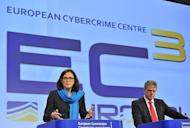 European Union commissioner for Home Affairs Cecilia Malmstroem (L) speaks next to the Head of the European Cybercrime Centre (EC3) Troels Oertin (R) during a press conference and presentation of the new European Cybercrime Centre on January 9, 2013, at the EU Headquarters in Brussels