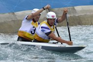 "Britain's Tim Baillie (R) and Etienne Stott compete in the Canoe Double Men's Slalom Final at the ""Lee Valley White Water Centre"", in London, on day 6 of the London 2012 Olympic Games. The pair won gold"