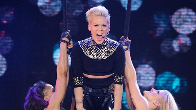 "FILE - This March 22, 2013 file photo shows singer Pink during her ""The Truth About Love"" tour at Madison Square Garden in New York. Pink's ""Just Give Me a Reason (feat. Nate Ruess),"" is the top song on  iTunes' Official Music Charts for the week ending April 15, 2013. (Photo by Evan Agostini/Invision/AP, file)"