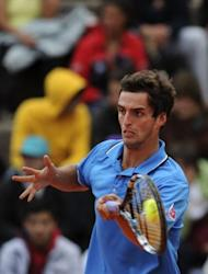 Albert Ramos of Spain returns the ball to Joao Sousa of Portugal on their Estoril Open tennis tournament quarter-final match in Oeiras, on the outskirts of Lisbon. Ramos won 6-2, 6-3