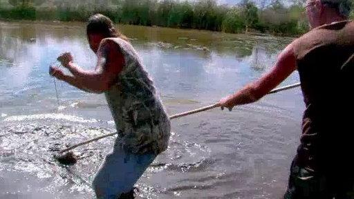 Roger Rivers Stabs a Gator at Devil's Ditch