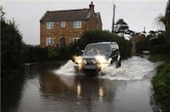 Deadly storms batter UK