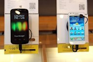 A Samsung Galaxy Nexus phones (L) is seen on display at a Sprint store, on April 27, in San Francisco, California. A judge on Friday granted Apple's request for an injunction blocking US sales of Samsung Galaxy Nexus, made in collaboration with Google to challenge the iPhone.