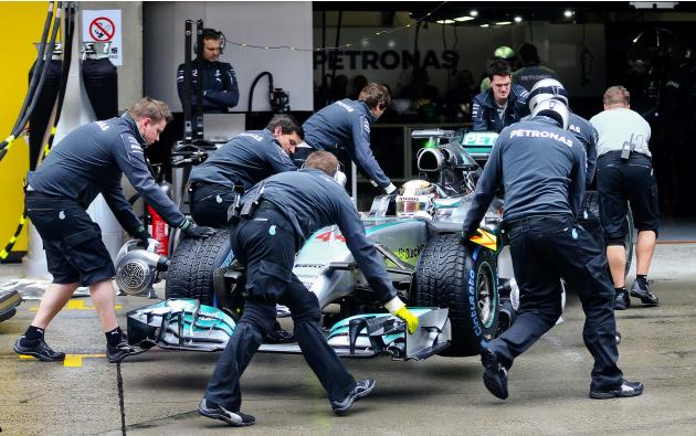 Mercedes Formula One driver Hamilton stops for a pit stop during the qualifying session for the the Chinese F1 Grand Prix at the Shanghai International circuit