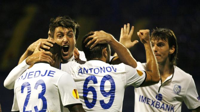 Chornomorets Odessa's players celebrate goal against Dinamo Zagreb during their Europa League  group B soccer  match,   in Zagreb, Croatia, Thursday, Sept. 19, 2013