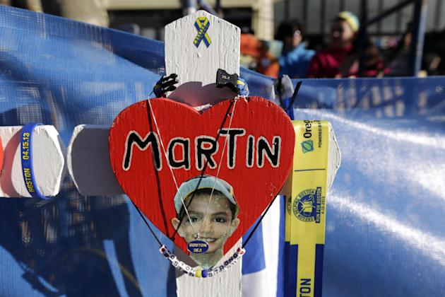 A memorial to 2013 Boston Marathon bombing victim Martin Richard sits near the starting line of the 118th Boston Marathon Monday, April 21, 2014 in Boston