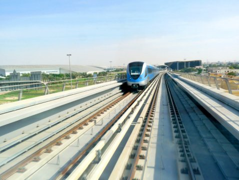 A train runs along the Dubai Metro.